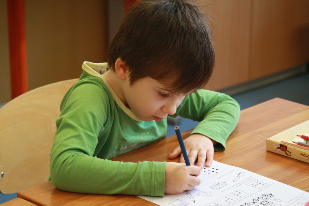 A child with ADHD working in a classroom